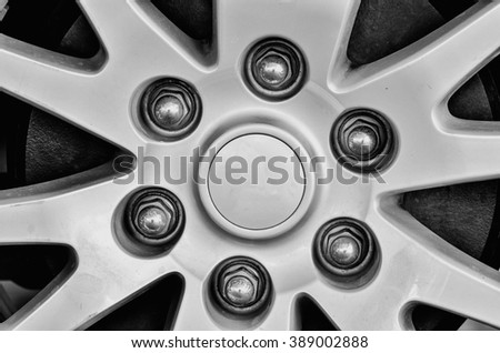 Close up of rims from a sport car in white and black - stock photo