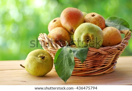 close up of ripe pears on basket - stock photo