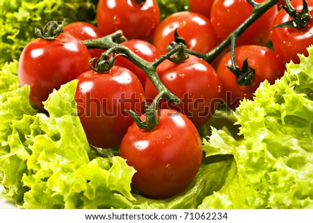 Close up of ripe red cherry tomatoes on lettuce