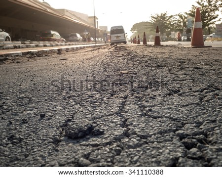 Close up of road cracked with vehicle and trouble transport .