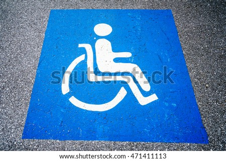 Close-up of road sign for disabled people