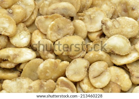 Close-up of roasted broad beans to use as background, also called horse beans  - stock photo