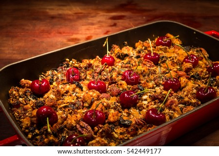 close up of roasted spicy chicken with berry decorate with red cherry