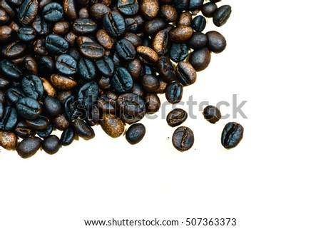 close up of robusta coffee beans hand roasting background with copy space