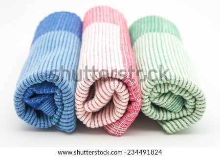 Close up of roll up colorful napkins or plate mates for table set up in restaurant or home