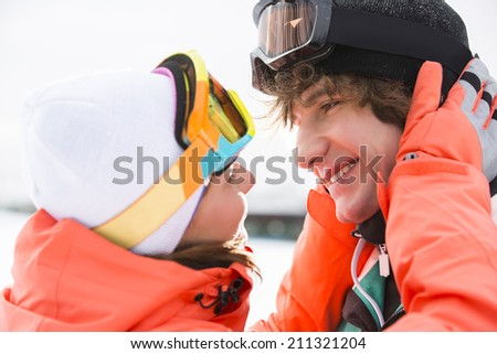 Close-up of romantic young couple about to kiss during winter - stock photo