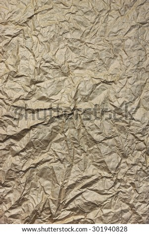 Close-up Of Rough Brown Wrinkled Packaging Paper Square Texture Vertical Background With Copy Space For Text Or Image - stock photo