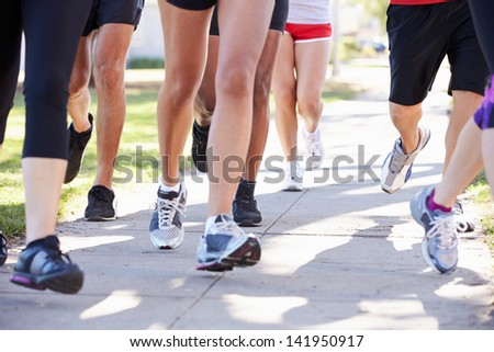 Close Up Of Runners Feet On Suburban Street