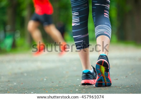 Close up of running shoes on road. Rear view. - stock photo