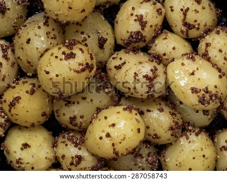 close up of rustic boiled potato in mustard food background