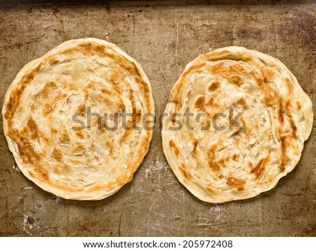 close up of rustic indian roti paratha fried pancake