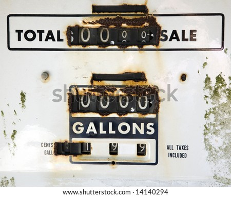 Close up of rusty gauge on old gas dispenser. - stock photo