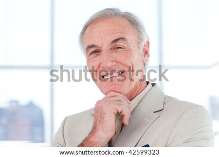 Close-up of s smiling senior businessman in a business building