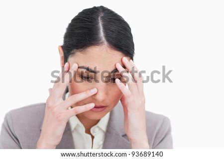 Close up of sad looking businesswoman against a white background