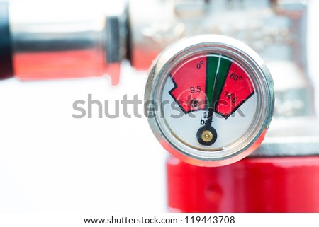 Close up of safety gauge of fire extinguisher - stock photo