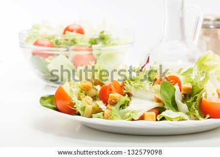 Close-up of salad. Lettuce, tomato, cucumber. Selective focus - stock photo