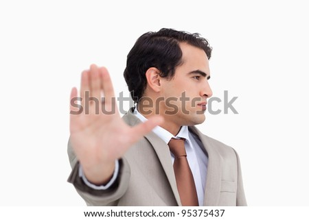 Close up of salesman signalizing stop against a white background - stock photo