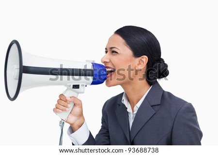 Close up of saleswoman shouting through megaphone against a white background