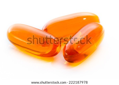 close up of salmon oil capsules isolated on a white background