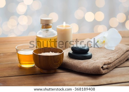 close up of salt, massage oil and bath stuff - stock photo