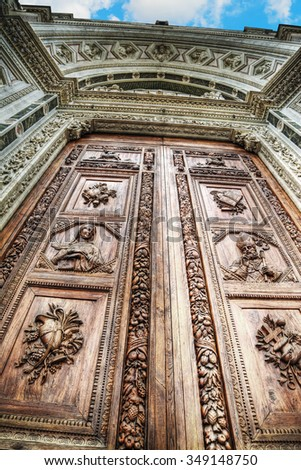 close up of Santa Croce front door in Florence, Italy