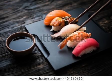 close up of sashimi sushi set with chopsticks and soy - stock photo