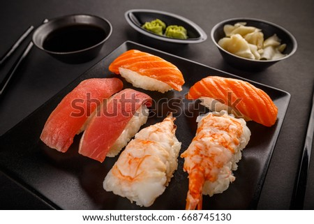 Close up of sashimi sushi set with soy sauce, wasabi and ginger