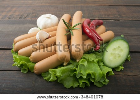 Close up of sausage and fresh vegetables - stock photo