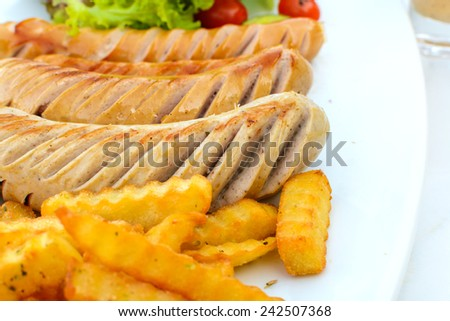 Close up of sausage with french fries - stock photo