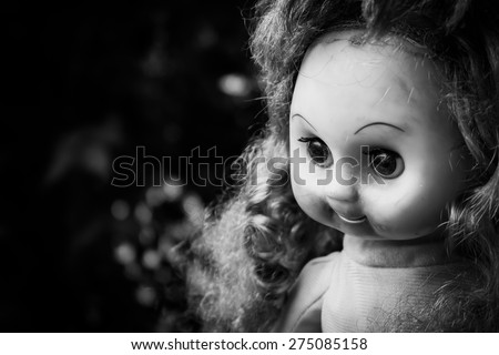 Close up of scary doll face. - stock photo