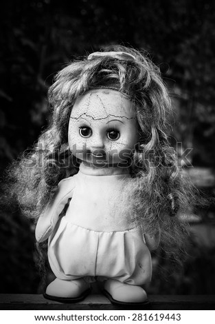 Close up of scary doll face.