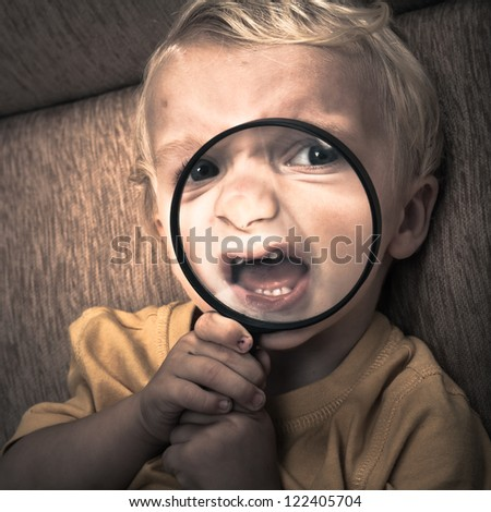 Close up of scary horror child boy face. - stock photo