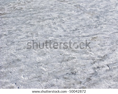 Close up of scratched snowy ice surface background - stock photo