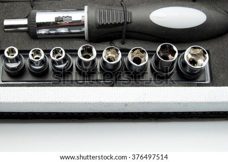 Close up of screwdriver with adjustable torque in tool box. Space for texts. - stock photo