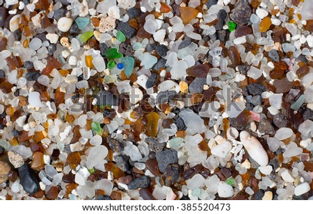Close up of sea glass,  'sand' on  Kauai's Glass Beach by Port Allen ,Eleele . Broken glass bottles that have been tumbled in the waves for a long time, make up a significant portion of the sand.