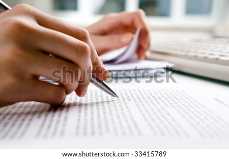 Close-up of secretary?s hands doing paperwork - stock photo