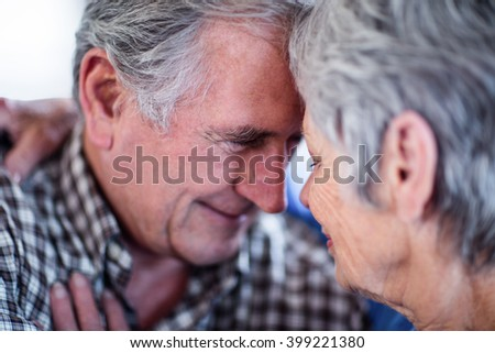 Close-up of senior couple smiling and embracing and each other - stock photo