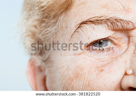 Close up of senior woman's eye - stock photo