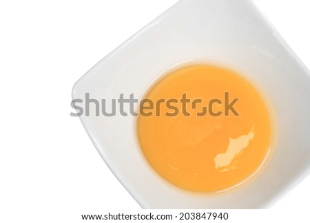 close up of separated egg white and yolk - stock photo