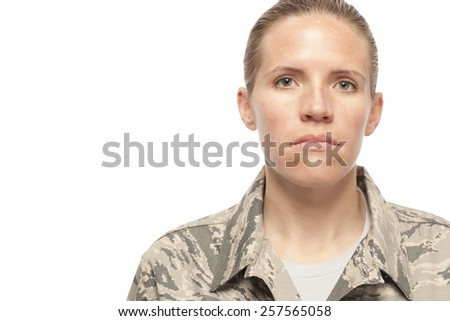 Close-up of serious female airman against white background - stock photo