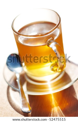 Close-up of served black tea in glass - stock photo