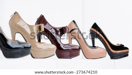 Close up of set of stylish shoes at the showcase in the shopping mall - stock photo