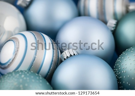 Close up of several blue Christmas glass baubles - stock photo