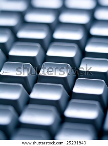 Close-up of several keys of computer keyboard with English letters on them