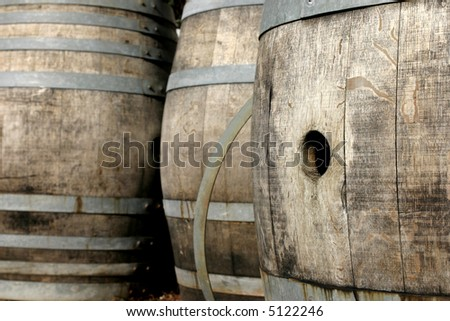 Close up of several old oak wine barrels. - stock photo