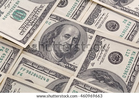 close up of several one hundred dollars banknotes