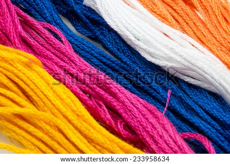 close up of several strands of soft colored cotton - stock photo