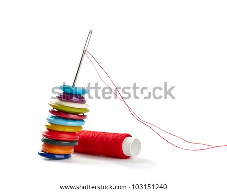 close up of  sewing items on white background