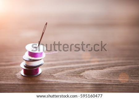 Close up of sewing items on wood background, tailoring theme