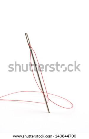 Close up of sewing needle on white background. - stock photo